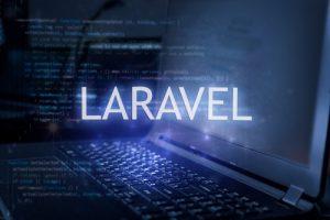 Laravel,Inscription,Against,Laptop,And,Code,Background.,Technology,Concept.