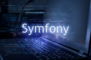 Symfony,Inscription,Against,Laptop,And,Code,Background.,Framework,For,Web