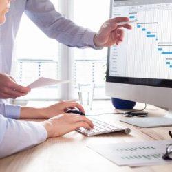 Project,Management,Team,Updating,Gantt,Chart,Schedule,Or,Planning,On
