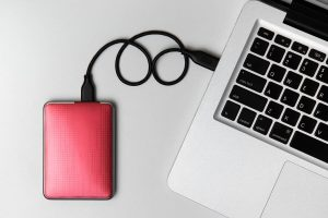 External Hard disk connect to laptop, External Hard disk and laptop computer, White background, Top view workspace